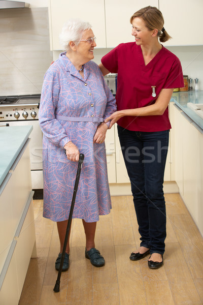 Senior woman and carer in kitchen Stock photo © monkey_business