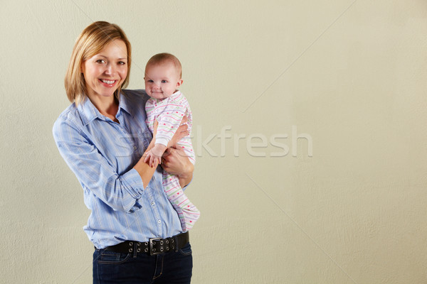 Studio Shot Of Happy Mother and Baby Stock photo © monkey_business