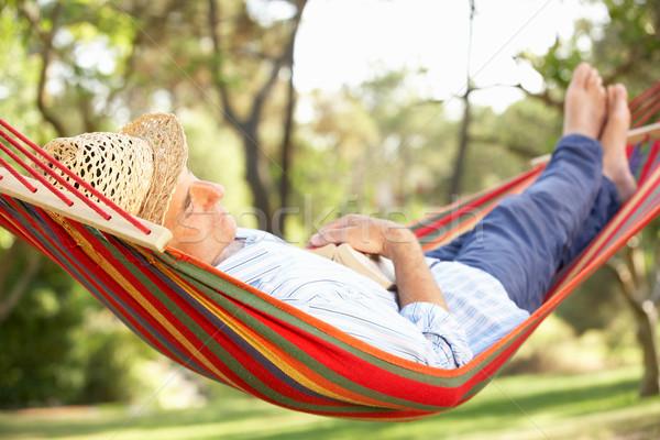 Stock photo: Senior Man Relaxing In Hammock