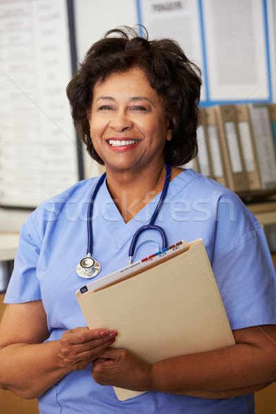 Female Nurse At Nurses Station Stock photo © monkey_business