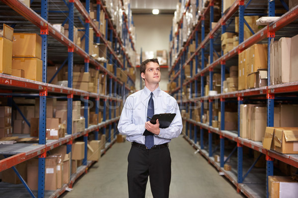 Gestionnaire entrepôt presse-papiers affaires boîte hommes Photo stock © monkey_business