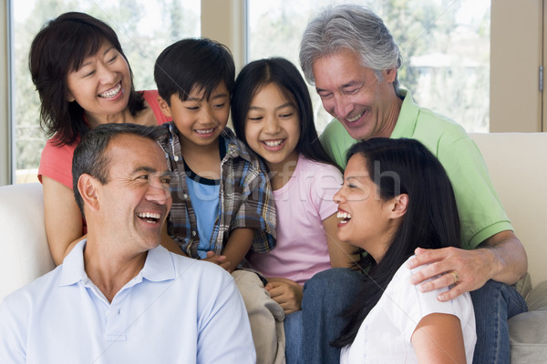 Extended family in living room smiling Stock photo © monkey_business