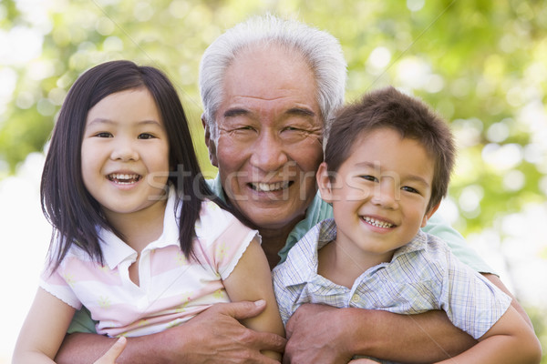 Grandfather posing with grandchildren Stock photo © monkey_business