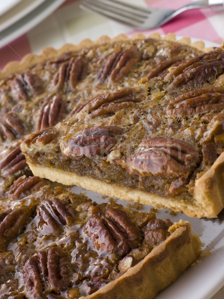 Pecan Pie With A Slice Being Cut Stock photo © monkey_business