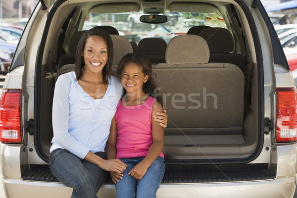 Woman with young girl sitting in back of van smiling Stock photo © monkey_business