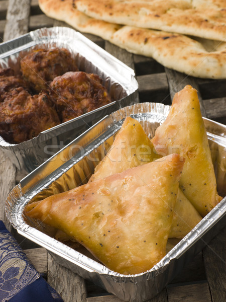 Indian Take Away- Vegetable Samosa, Naan Bread And Onion Bahji Stock photo © monkey_business