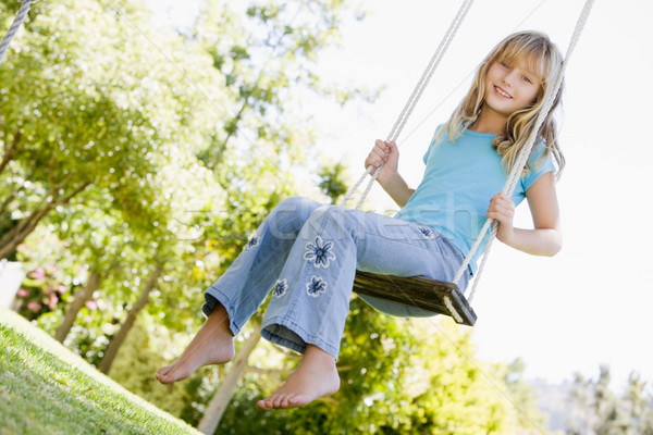 Young girl sitting on swing smiling Stock photo © monkey_business