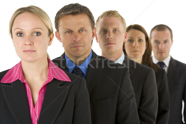 Group Of Business People In A Line Looking Serious  Stock photo © monkey_business