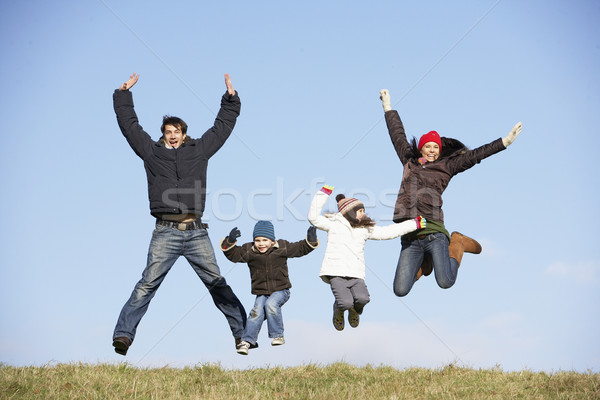 Famille sautant air homme hiver parc Photo stock © monkey_business