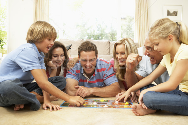 Stock photo: Family Playing Board Game At Home With Grandparents Watching