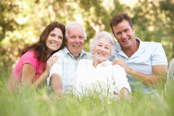 Senior Couple With Grown Up Children In Park Stock photo © monkey_business