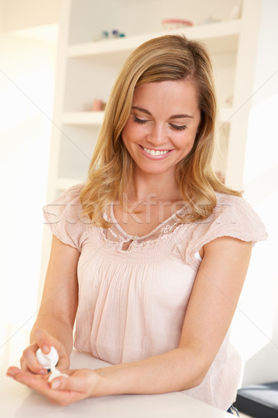 Young woman using hand sanitizer Stock photo © monkey_business
