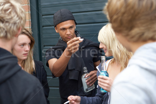 Group Of Threatening Teenagers Hanging Out Together Outside Drin Stock photo © monkey_business