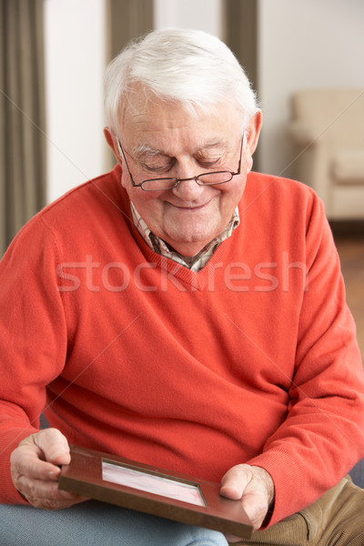 Senior Man Looking At Photograph In Frame Stock photo © monkey_business