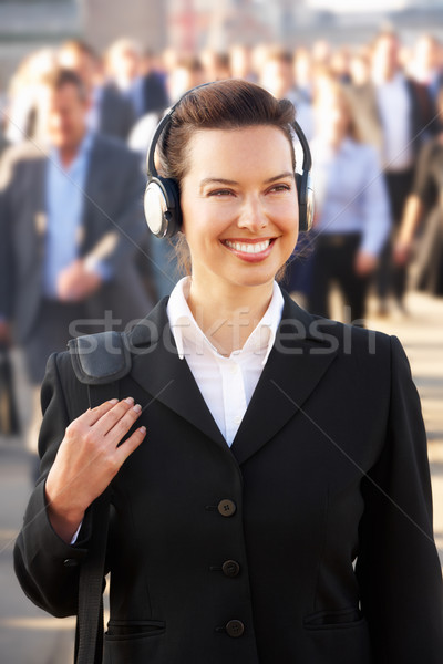 Female commuter in crowd wearing headphones Stock photo © monkey_business