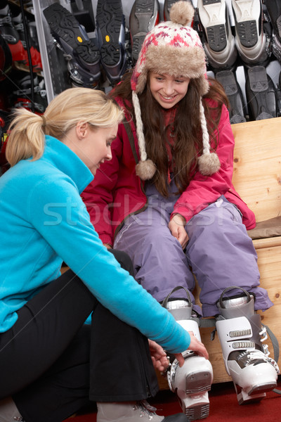 Sales Assistant Helping Teenage Girl To Try On Ski Boots In Hire Stock photo © monkey_business