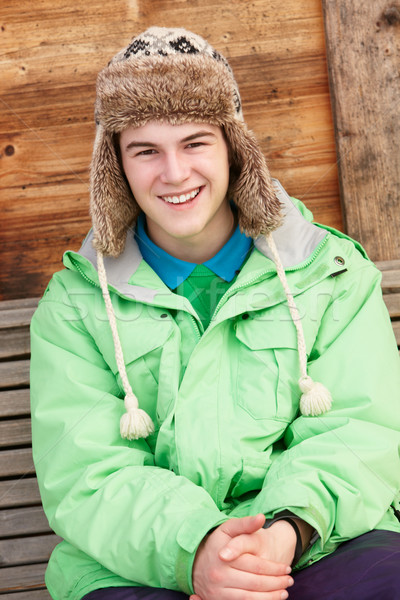 Teenage Boy Dressed For Cold Weather Sitting On Wooden Bench Stock photo © monkey_business