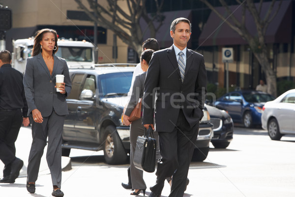 Group Of Businesspeople Crossing Street Stock photo © monkey_business
