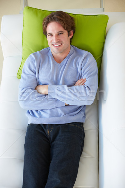 Overhead View Of Man Relaxing On Sofa Stock photo © monkey_business