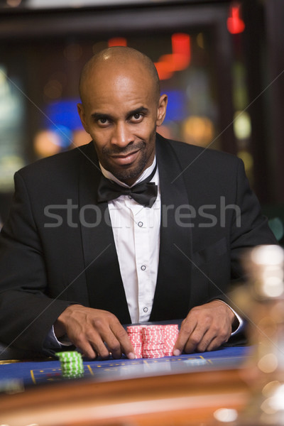 Man gambling in casino at roulette table Stock photo © monkey_business