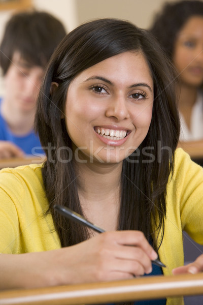 Female college student in a university lecture hall Stock photo © monkey_business