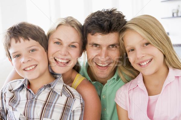 Familia salón sonriendo nina hombre feliz Foto stock © monkey_business