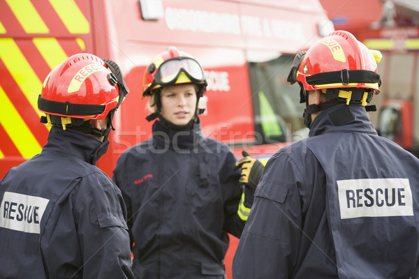 A firefighter giving instructions to her team Stock photo © monkey_business