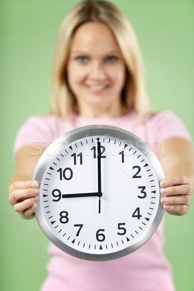 Woman Holding Clock Showing 9 O'Clock Stock photo © monkey_business