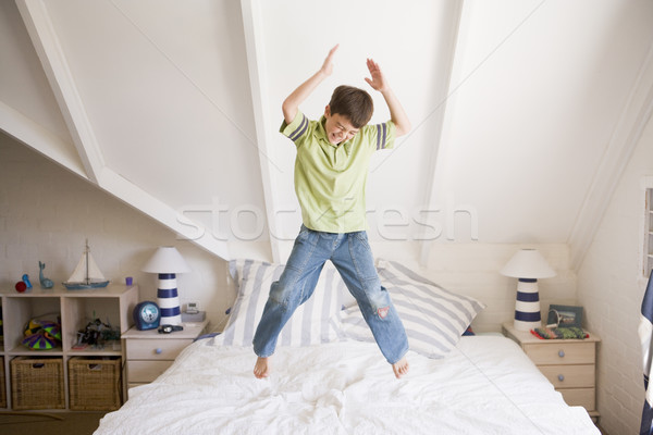 Young Boy Jumping On His Bed Stock photo © monkey_business