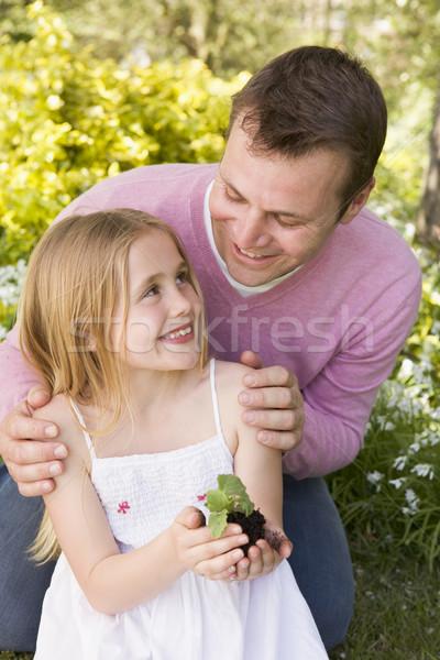 Apa lánygyermek kint tart növény mosolyog Stock fotó © monkey_business