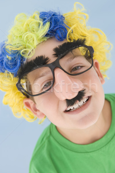 Young boy wearing clown wig and fake nose Stock photo © monkey_business