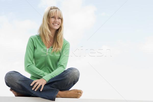 Young woman sitting outside Stock photo © monkey_business