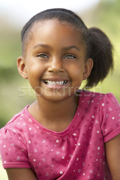 Portrait Of Young Girl Sitting In Park Stock photo © monkey_business