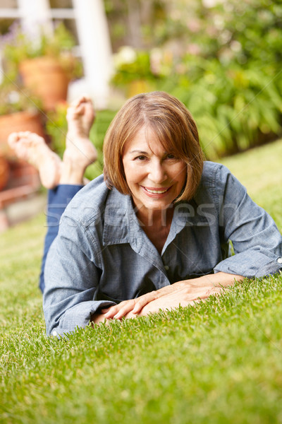 Stock photo: Mid age woman relaxing in garden