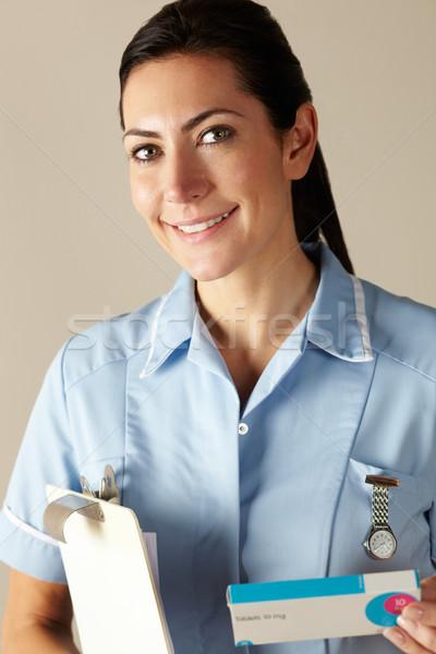 Enfermeira prescrição droga empacotar mulher Foto stock © monkey_business