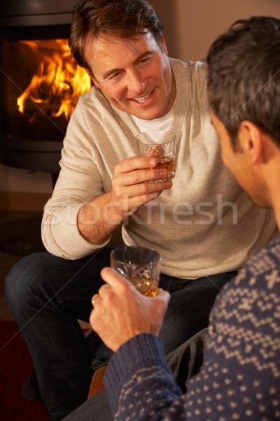 Due di mezza età uomini rilassante seduta divano Foto d'archivio © monkey_business