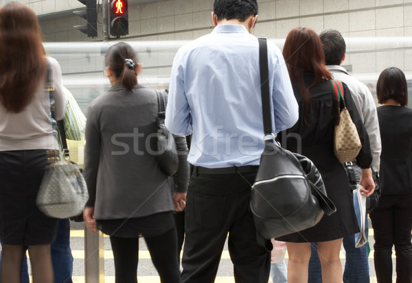 Stock photo: Commuters Crossing Busy Hong Kong Street