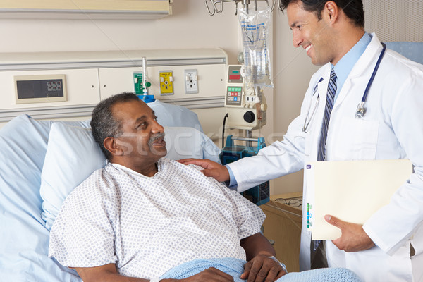 Stock photo: Doctor Visiting Senior Male Patient On Ward