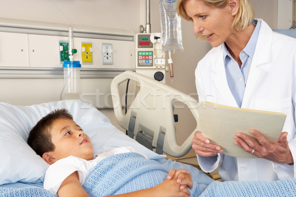Doctor Visiting Child Patient On Ward Stock photo © monkey_business