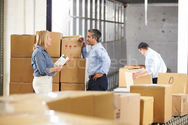 рабочие товары пояса распределение склад человека Сток-фото © monkey_business