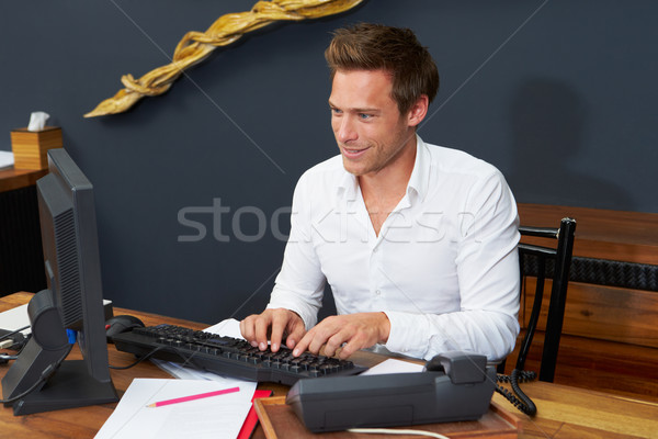 Hotel Receptionist Working At Computer Stock photo © monkey_business