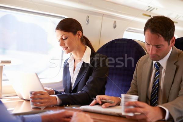 Zakenvrouw woon-werkverkeer werk trein met behulp van laptop vrouwen Stockfoto © monkey_business