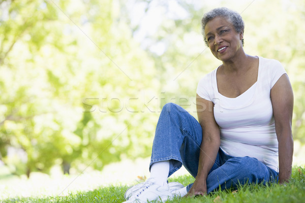 Stock photo: Senior woman relaxing in park
