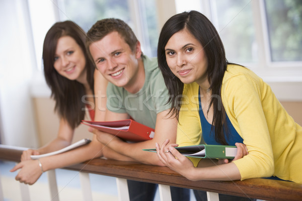 Three college students leaning on banister Stock photo © monkey_business