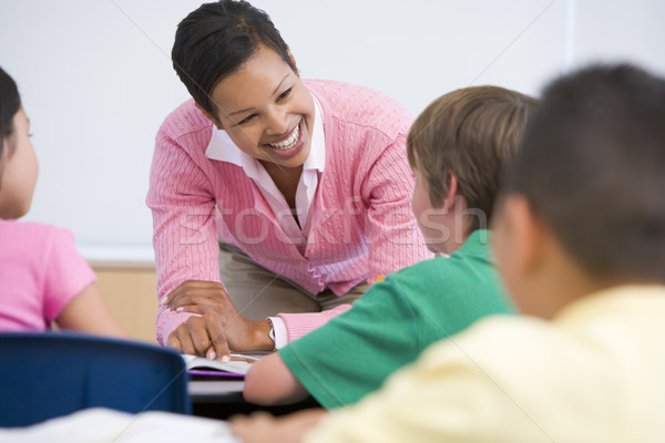Elementary school teacher with pupils Stock photo © monkey_business