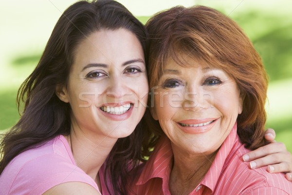 Deux femmes permanent extérieur souriant amour enfant Photo stock © monkey_business