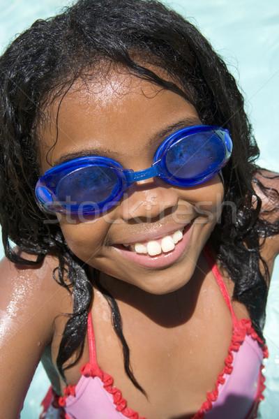 Fiatal lány úszómedence visel védőszemüveg mosolyog gyerekek Stock fotó © monkey_business