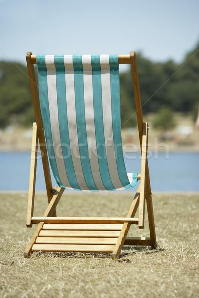 Egyedüli napozószék ül víz szék folyó Stock fotó © monkey_business