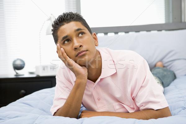 Tizenéves fiú ágy tini fiú lehangolt szabadidő Stock fotó © monkey_business