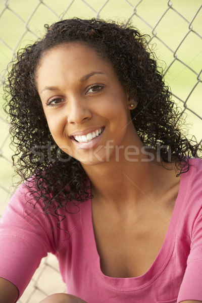 Adolescente séance aire de jeux fille heureux Teen Photo stock © monkey_business